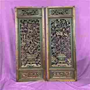 A pair of wood carved panels