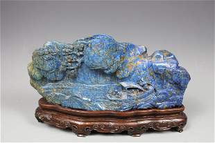A Carved Lapis Lazuli Boulder With Stand, Qing Dynasty