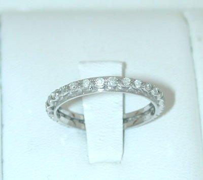 12145: 5971 18KW Gold Ring w/ Diamonds