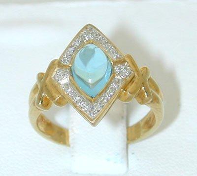 12257: 7411 9k Gold Blue Topaz Ring w/Diamond