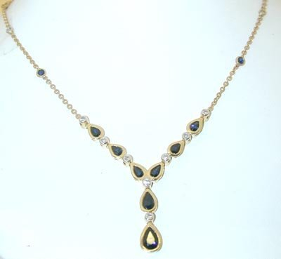 64: 064 14K Gold Necklace w/ Sapphire/ Diamonds