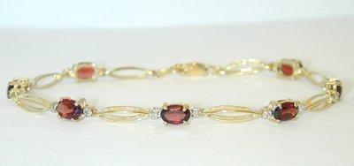 1018 10K Gold Bracelet w/ Garnet