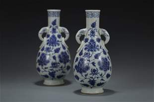 A PAIR OF BLUE & WHITE TWIN-HANDLED VASES. YUAN