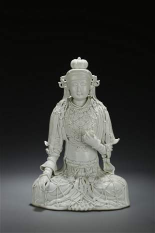 A FINELY CARVED Hutian WHITE-GLAZED FIGURE OF GUANYIN.