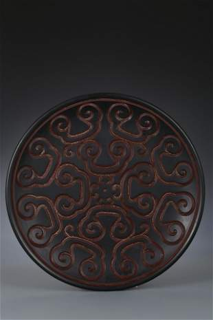 A FINELY CARVED TIXI LACQUER DISH. QIANLONG PERIOD,