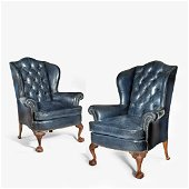 A pair of leather wing armchairs, Circa 1910