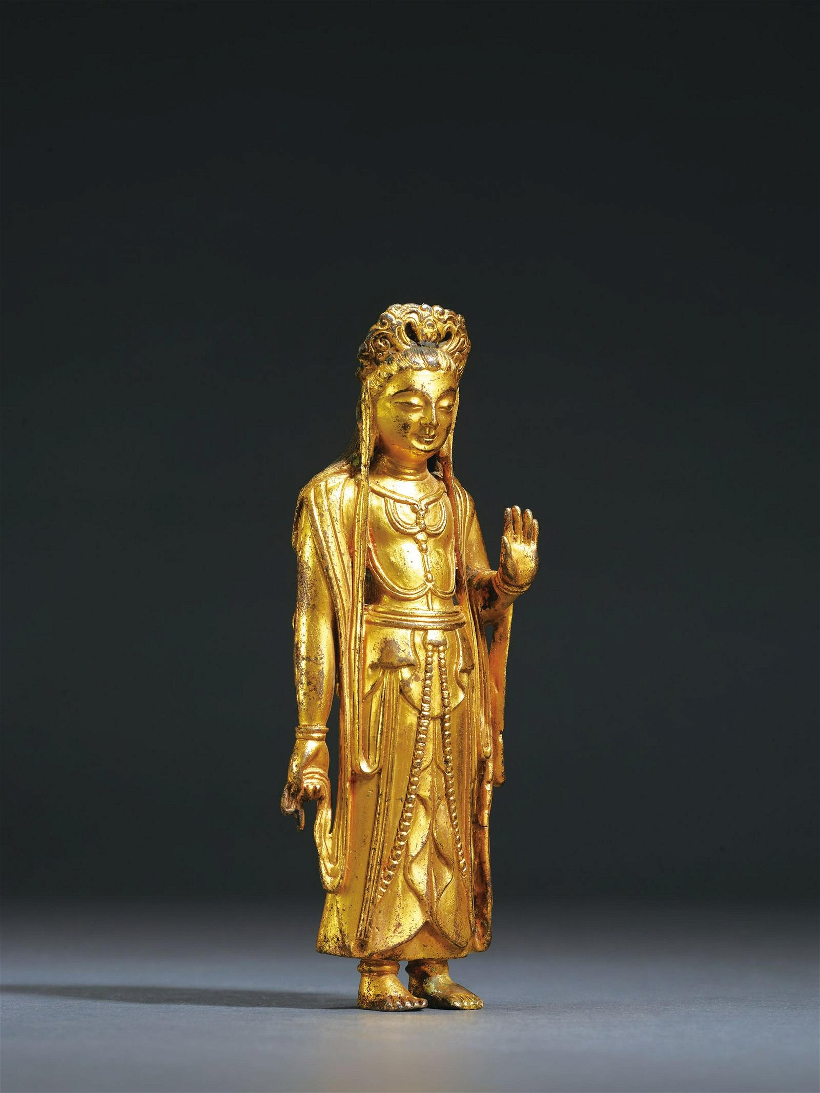 A GILT-BRONZE FIGURE OF STANDING BUDHISATTVA