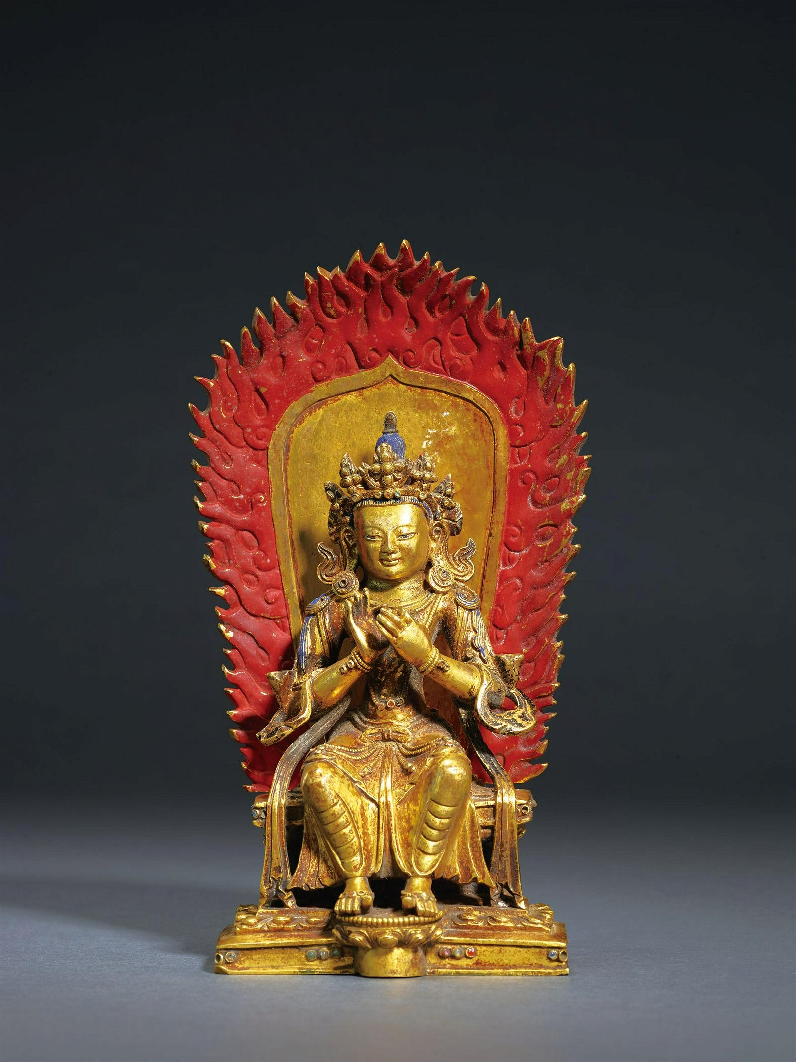 A GILT-BRONZE FIGURE OF MAITREYA