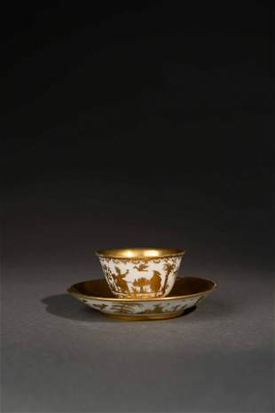 A SET OF MEISSEN CUP AND SAUCER DECORATED WITH GOLDEN