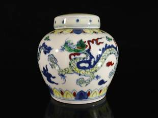 A Fine Blue and White Wucai Dragon Pattern Jar