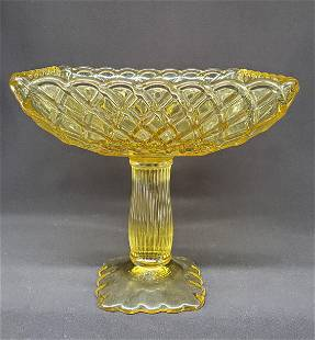 Vintage yellow footed glass compote
