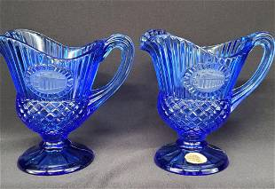 Pair of two matching Vintage pitchers