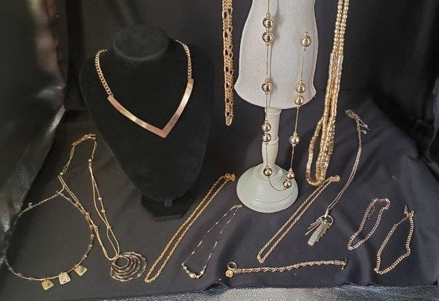 Collection of gold and gold tone jewelry
