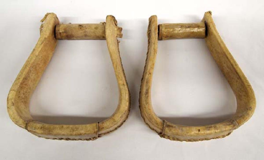 2 Rawhide Covered Wood Stirrups