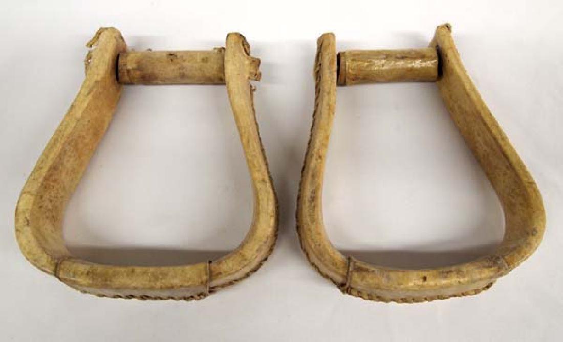 2 Rawhide Covered Wood Stirrups