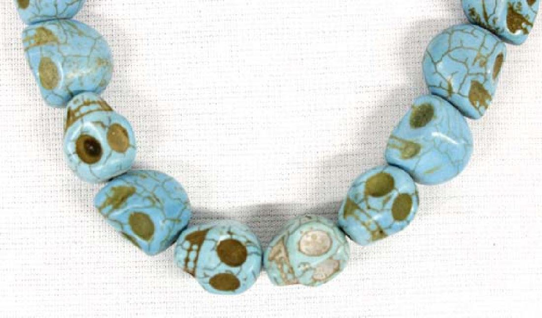 Strand of 24 Stabilized Turquoise Skull Beads