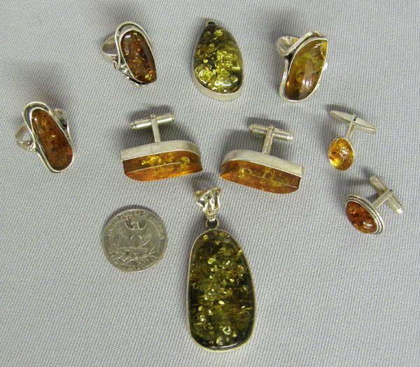 1022: 9 Pieces Misc. Amber Jewelry Largest Ring Size 9