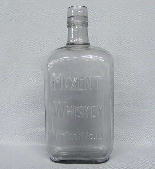 1006: Vintage Maxent Purple Whiskey Bottle 8'' High