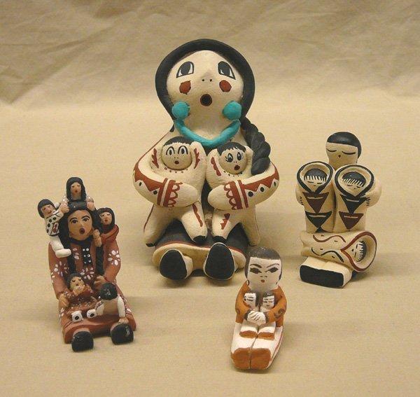 1051: 4 Pueblo Storyteller Pottery Dolls; 3.25'' tall