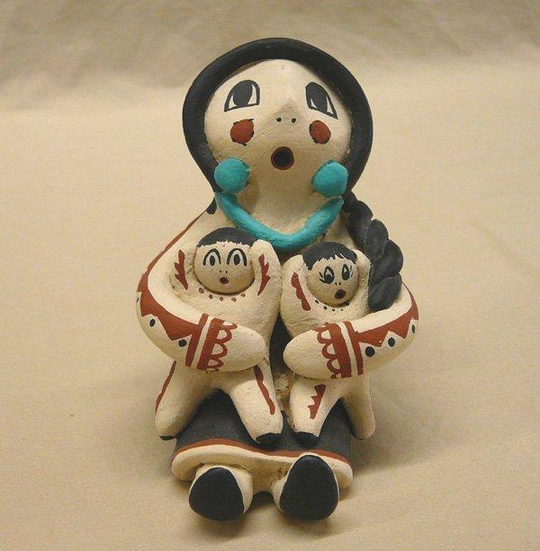 1051: 4 Pueblo Storyteller Pottery Dolls; 3.25'' tall - 2