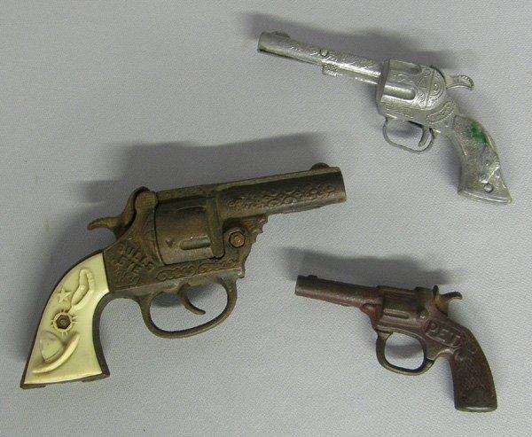 1018: 3 Cowboy Toy Cap Guns Largest 7''L