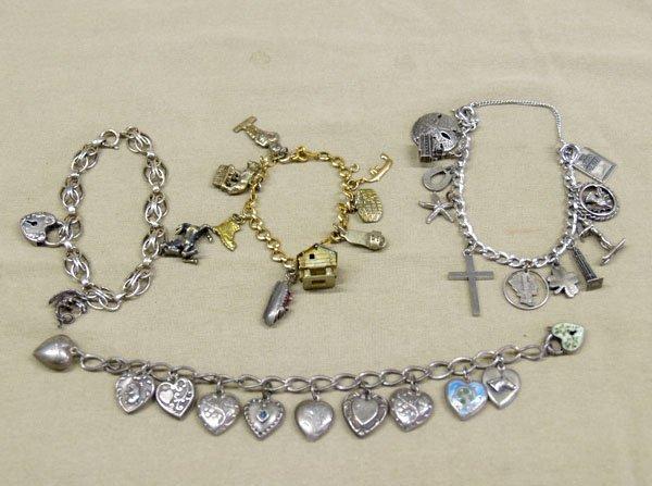 1305: 4 Estate Charm Bracelets, 1 with sterling silver