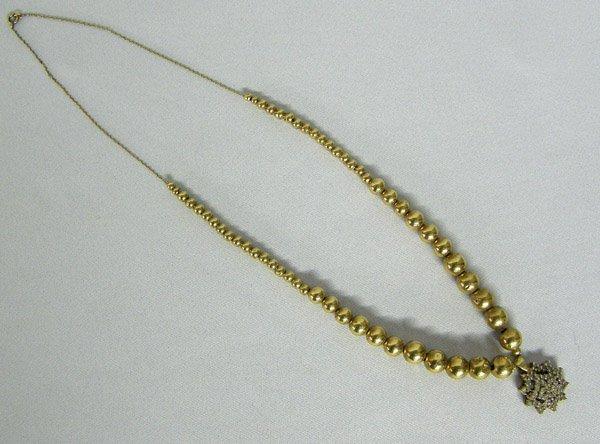 1021: Estate 10kt Gold CZ Pendant Necklace