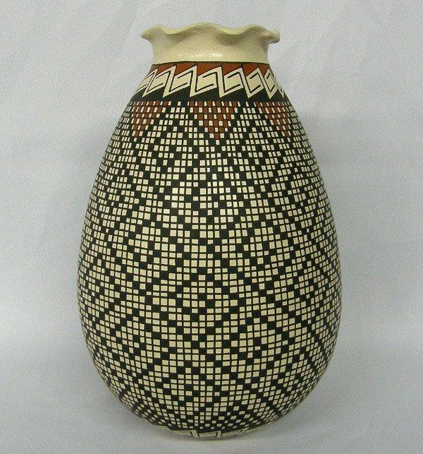 1304: Mata Ortiz Eye Dazzler Pottery By Rosa Gaona