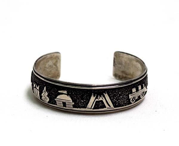 Navajo Silver Storyteller Bracelet By Thomas Singer