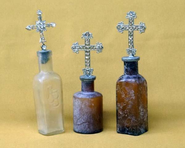 Antique Bottles with Rhinestone Cross Tops