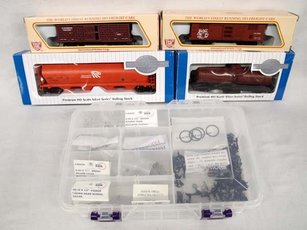 4 Train Cars and Box of Accessories
