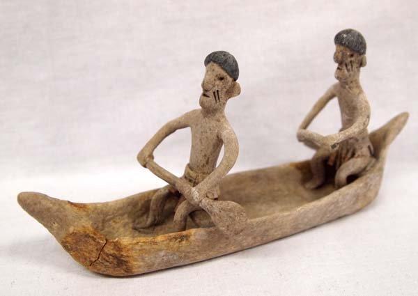 Amazonian Indigenous Men in a Canoe