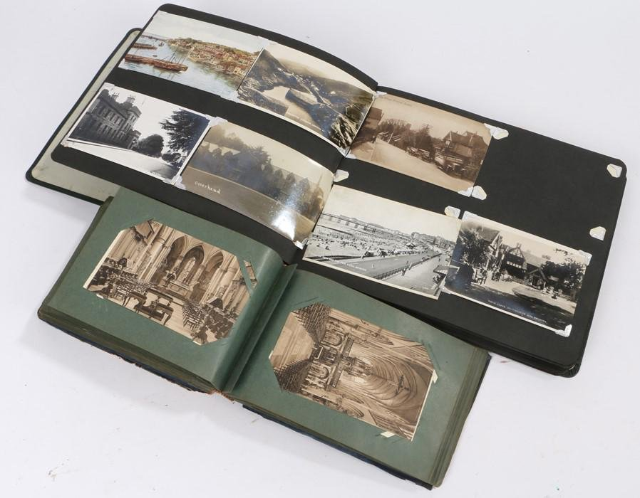 Two postcard albums, with First World War military