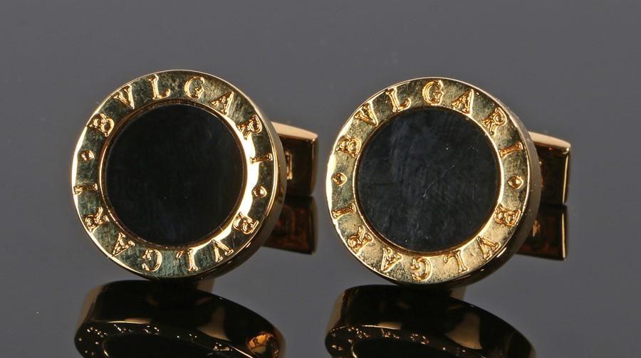 Pair of Bvlgari cufflinks, with onyx heads to gilt