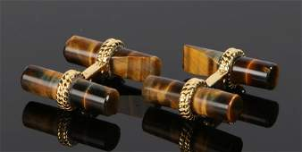 Pair of tigers eye cufflinks with cylinder ends and