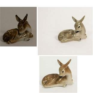 Ceramic figures, three lying brown young deer