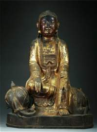 A CHINESE LACQUER-GILT BRONZE FIGURE OF GUANYIN