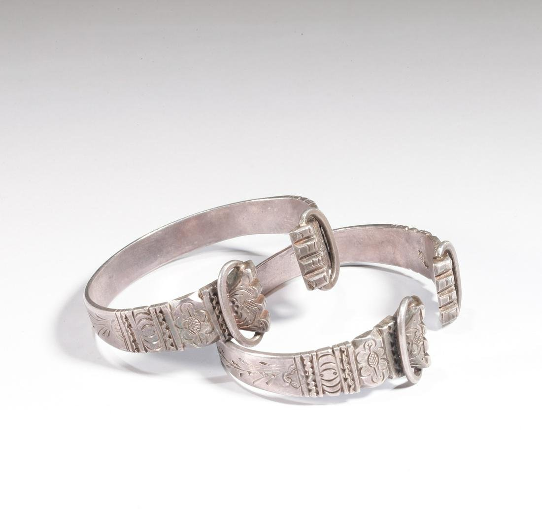 A PAIR OF SILVER BRACELETS