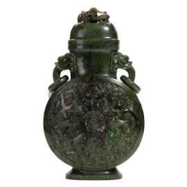 A CHINESE CARVED SPINACH-GREEN JADE VASE