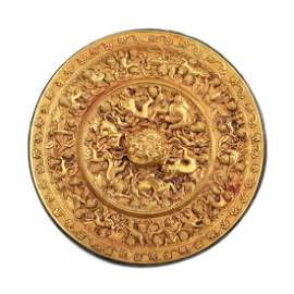 A CHINESE COPPER-INLAID MYTHICAL BEAST GOLD MIRROR