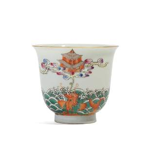A FAMILLE-ROSE 'DRAGON AND WAVES' CUP