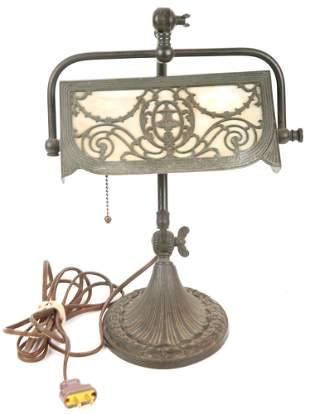 EARLY 20TH C. BRASS & IRON DESK LAMP - SLAG GLASS SHADE