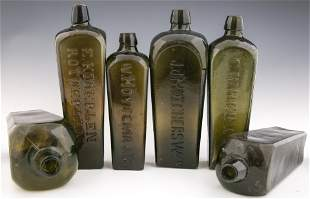 LATE 19TH AND 20TH C. GLASS GIN BOTTLES - LOT OF 6