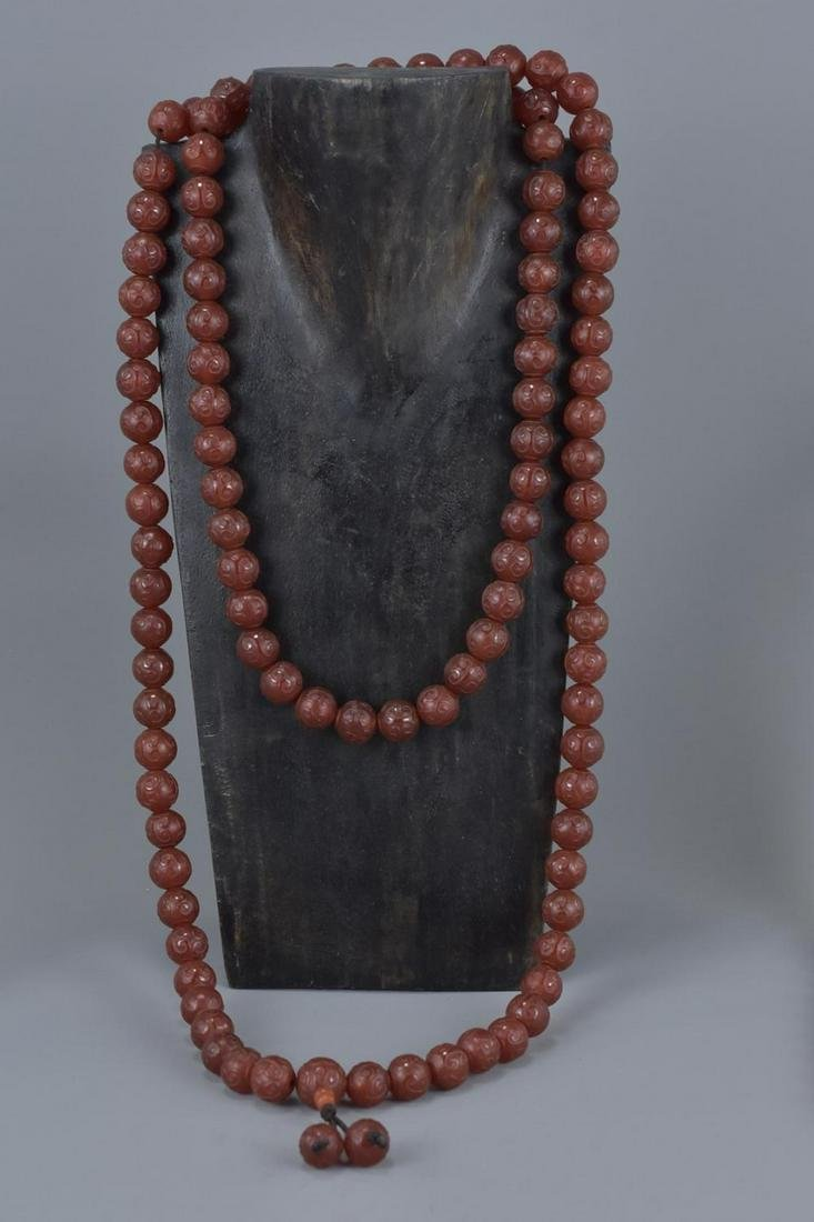 A large Chinese Buddhist agate beaded necklace