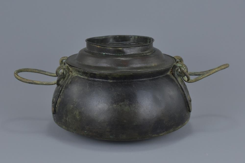 A Chinese Han dynasty bronze cooking pot