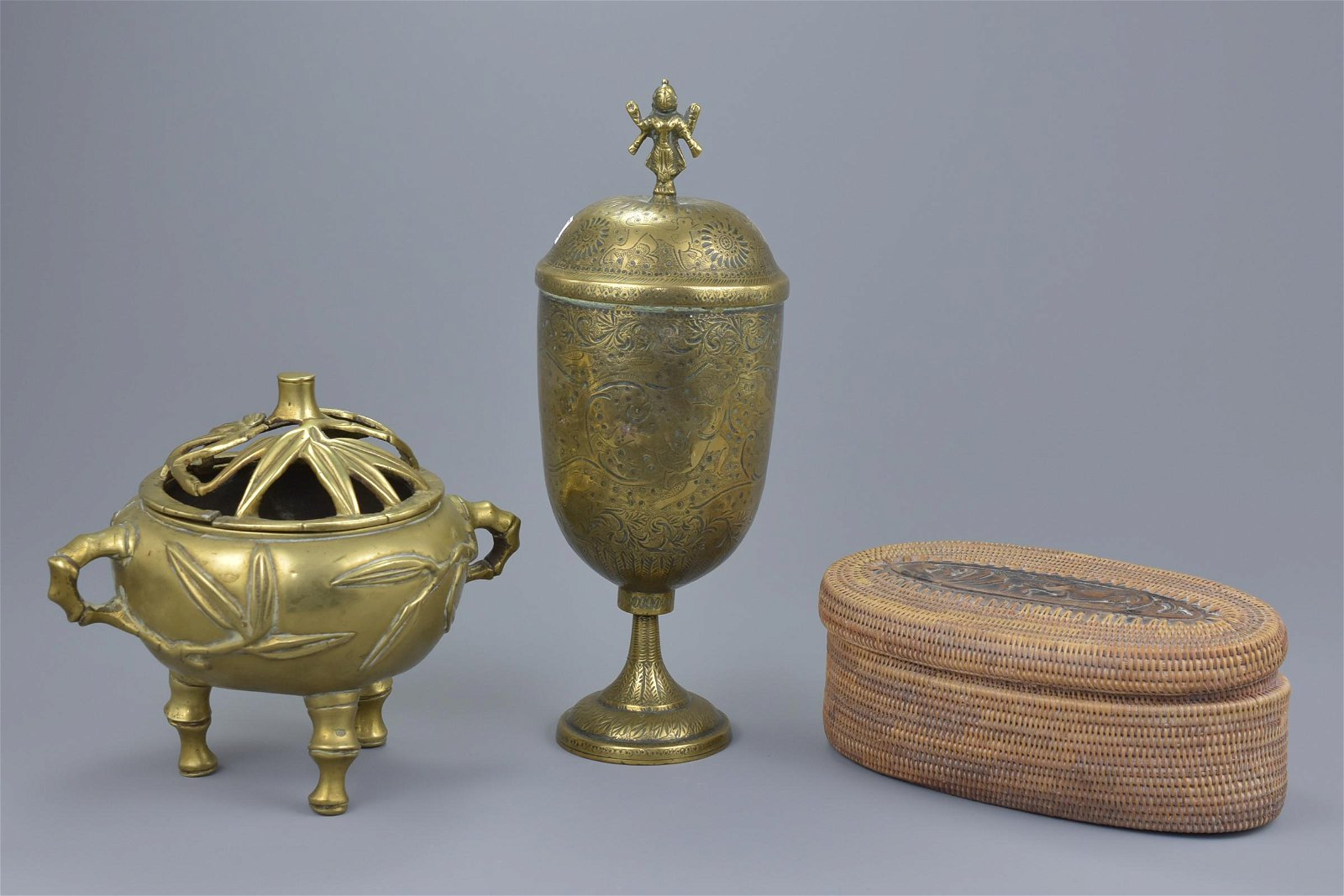 A Chinese polished bronzetripodcenser with