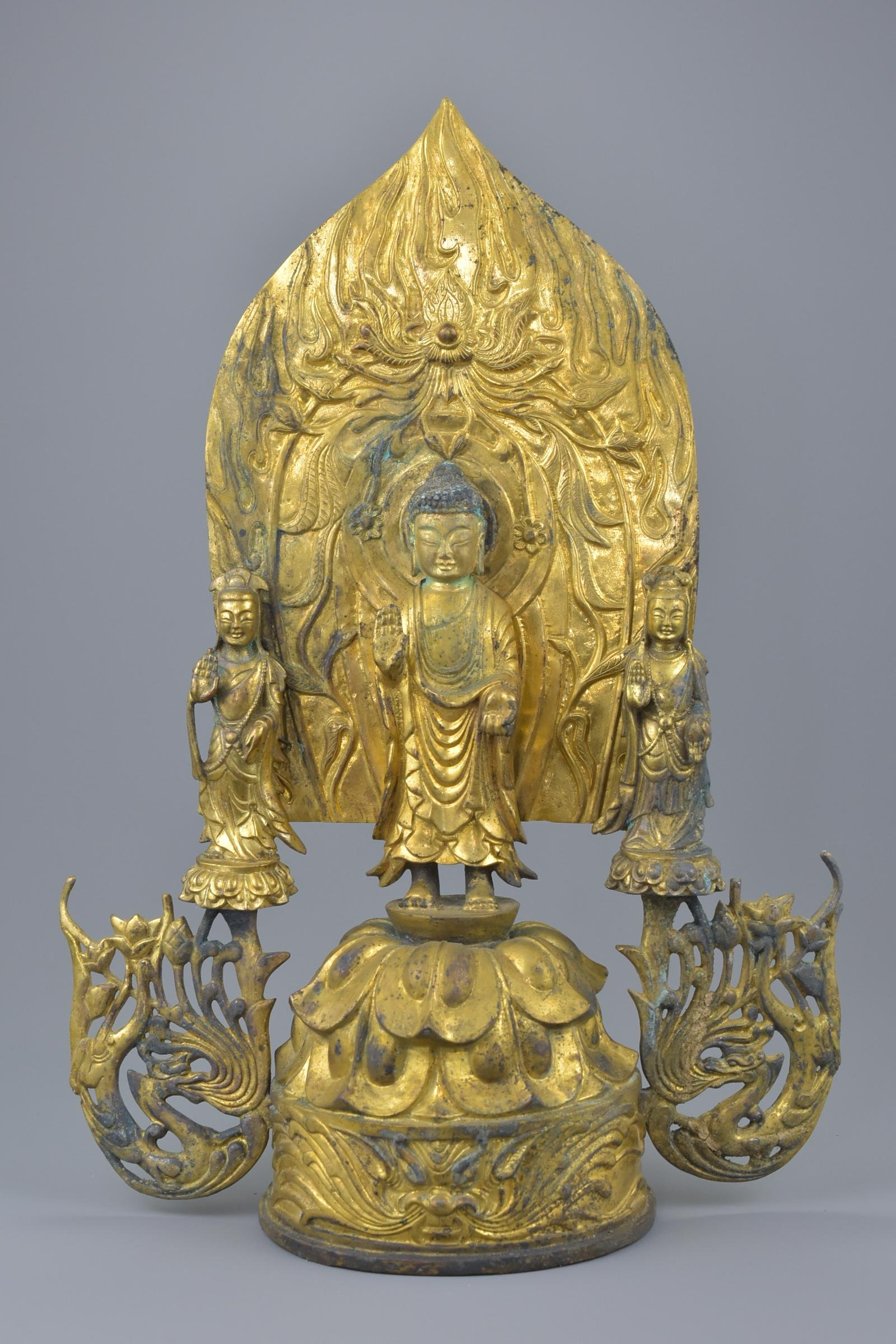 A large Chinese gilt bronze shrine of Buddha and two