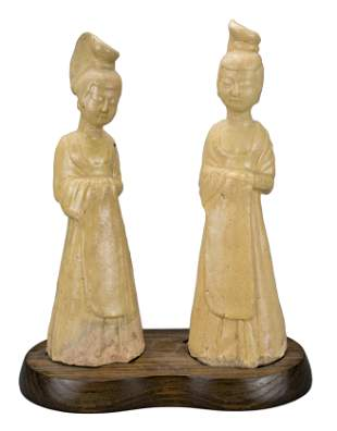 TWO CHINESE STAW-GLAZED POTTERY FIGURES OF LADIES, SUI