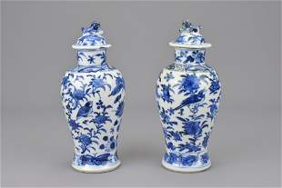 Two chinese blue and white porcelain vases with covers.