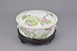 A chinese famille rose soup tureen on wooden stand